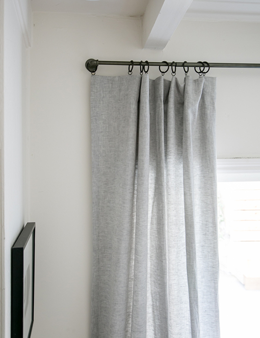 gray linen curtains with bronze rings and industrial pipe rod / sfgirlbybay