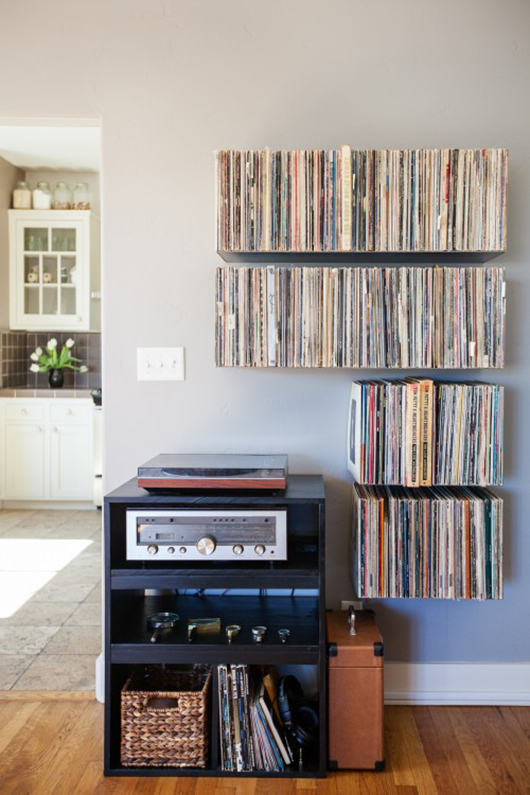 record player below records on floating shelves / sfgirlbybay