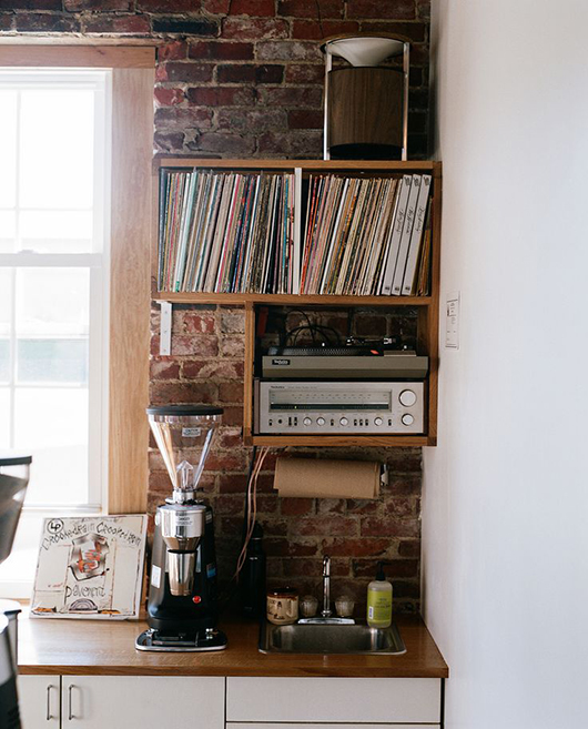 record player and records stored in mounted shelving unit / sfgirlbybay