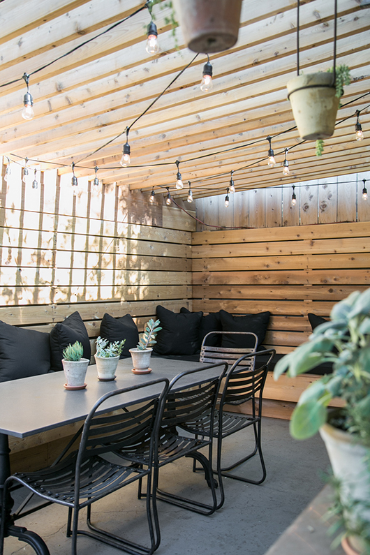 western red cedar wood pergola with string lights and potted plants / sfgirlbybay