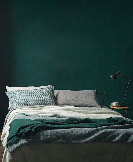 dark green bedroom wall with bedding in shades of green and gray / sfgirlbybay