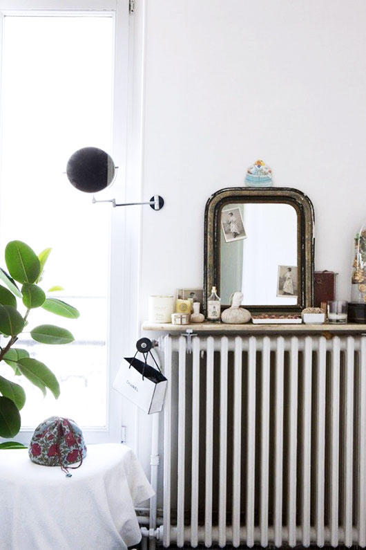 old radiator styled with vintage mirror and housewares / sfgirlbybay