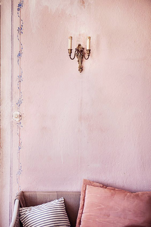 well-worn pale pink wall with candle sconce / sfgirlbybay