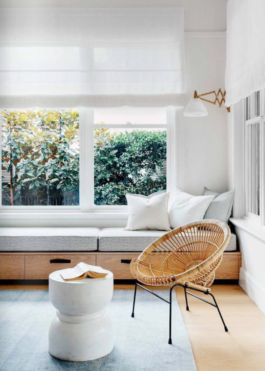 wicker chair and upholstered window bench with drawers via remodelista. / sfgirlbybay