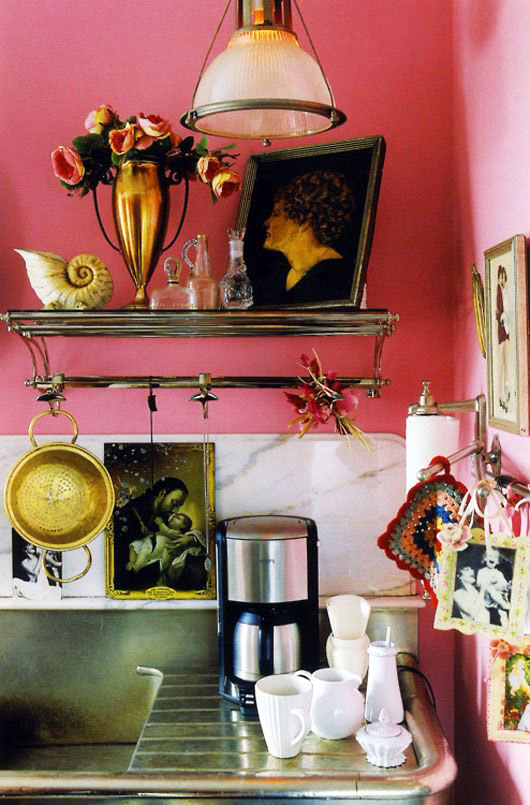 hot pink walls in kitchen with wall art and accessories hung / sfgirlbybay