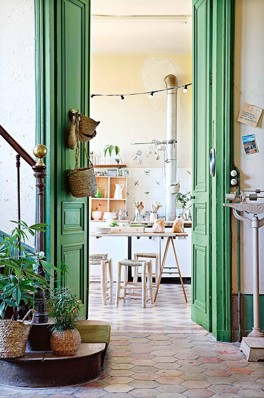 tall green doors inside 12th-century french chateau / sfgirlbybay