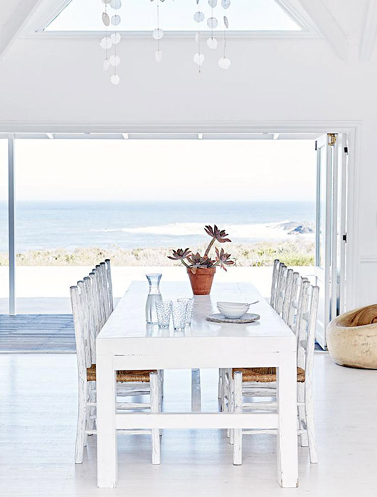 modern white dining table with matching chairs and potted succulent / sfgirlbybay