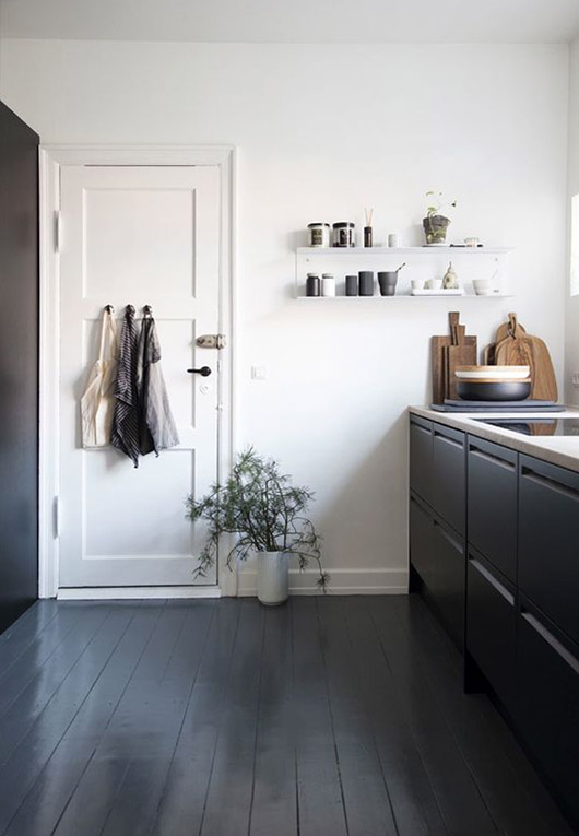 sleek black and white kitchen with painted black floors and cabinets / sfgirlbybay