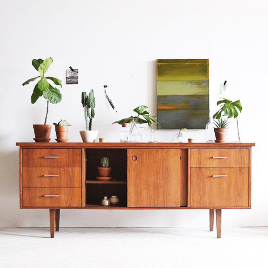 mid-century modern credenza with potted plants / sfgirlbybay