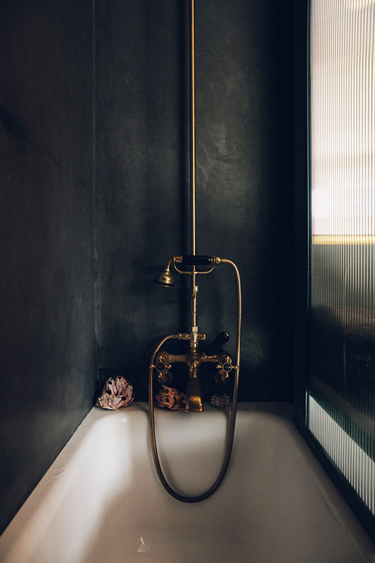 black stall with vintage shower fixture. / sfgirlbybay
