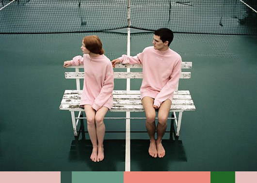 models photographed in pink sweaters on green tennis court. / sfgirlbybay