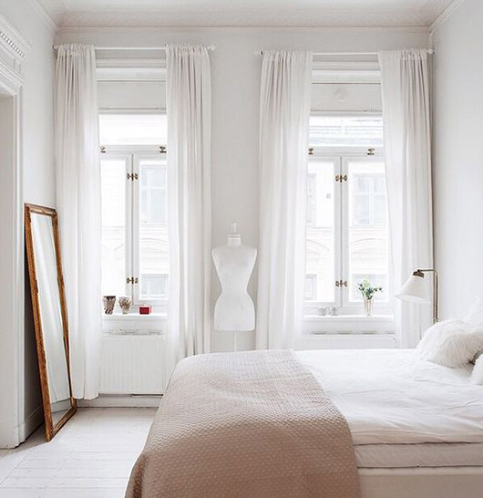 simple white bedroom with tall ceilings and windows. / sfgirlbybay