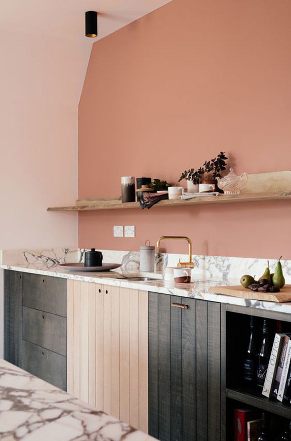 devol kitchens mixes pink walls with marble countertops and brass fixtures. / sfgirlbybay