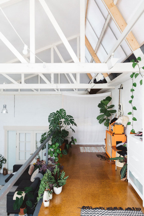 plant-filled ceramic studio with white walls and painted beamed ceilings. / sfgirlbybay
