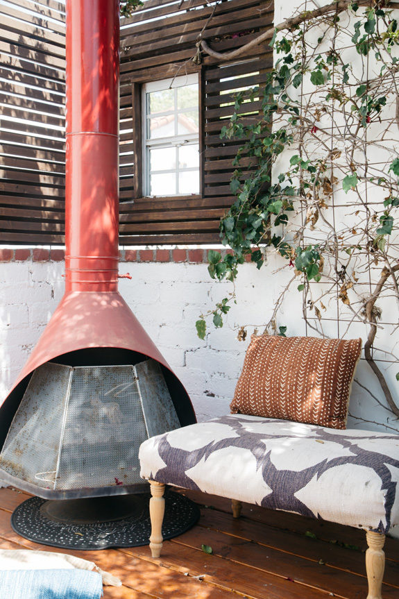 red mid-century modern outdoor fireplace. / sfgirlbybay