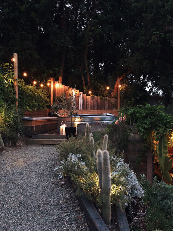 string lights in backyard with built-in seating and cowboy pool. / sfgirlbybay