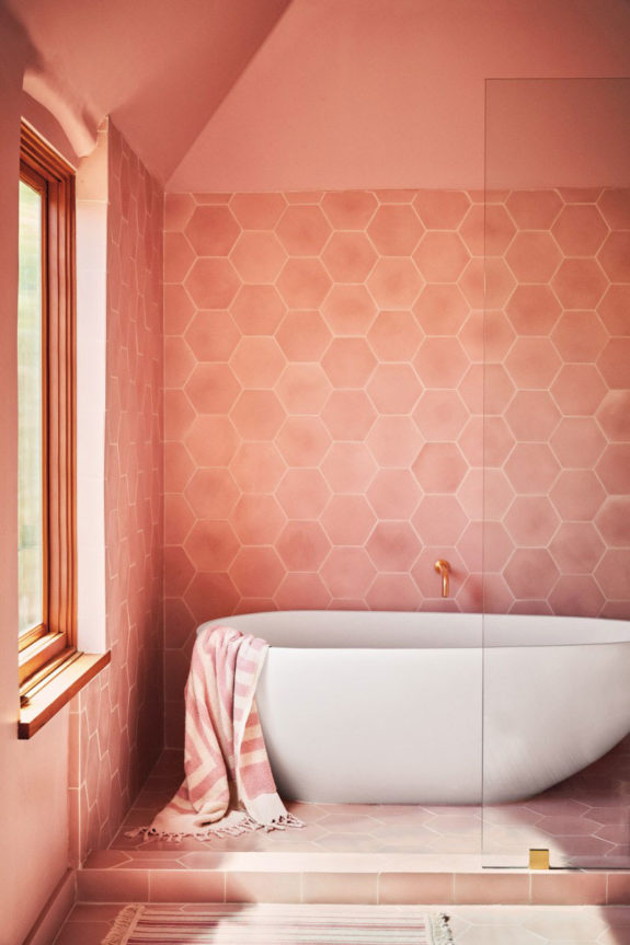coral pink wall paint and tile in modern bathroom with freestanding tub. / sfgirlbybay