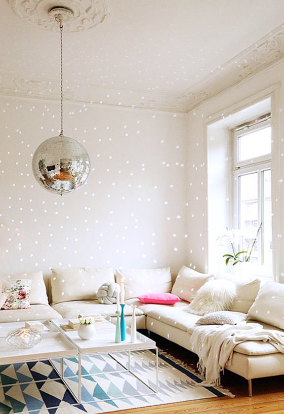disco ball hung from ornate ceiling medallion in modern living room. / sfgirlbybay