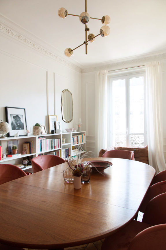 dining room in paris apartment with pink velvet chairs. / sfgirlbybay