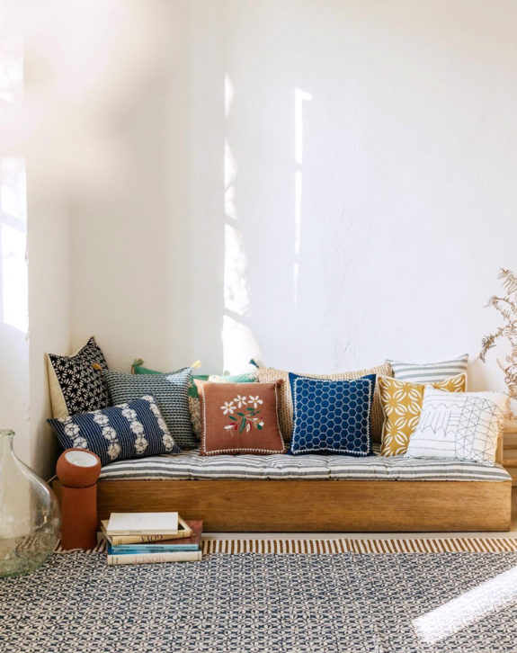 wood platform daybed with colorful patterned pillows. / sfgirlbybay