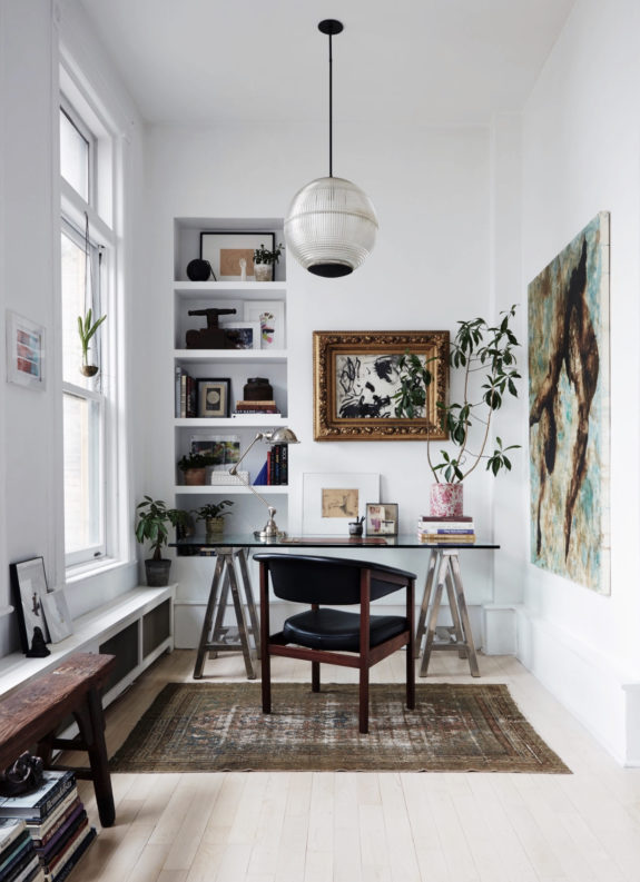 inspiring home office nook with glass and chrome desk and leather and wood chair and large pendant lighting fixture. / sfgirlbybay