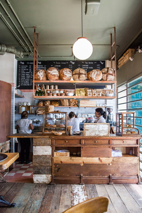bakery with vintage wood cabinets and counter inside lardo restaurant in mexico city. / sfgirlbybay