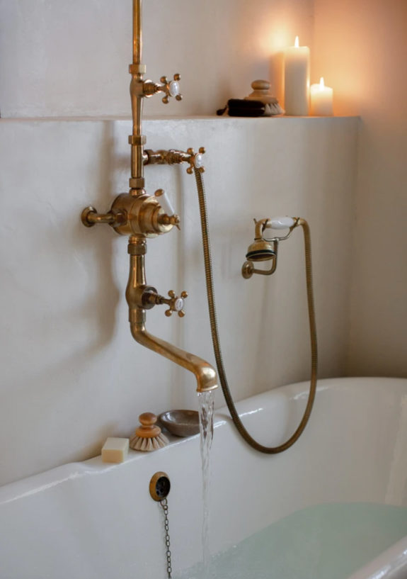 brass bathtub fixtures. / sfgirlbybay